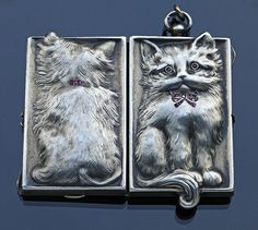 This is not contemporary - image from a gallery of vintage and/or antique objects. ART NOUVEAU  Cat Locket  Silver Ruby Diamond