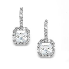 """Glistening with more sparkle than you'd expect from their 1 1/8"""" h x 1/2 w size, Mariell's bridal or bridesmaids drop earrings feature a breathtaking Radiant Cut Cubic Zirconia gracefully suspended from a deiicate row of inlaid CZ's."""