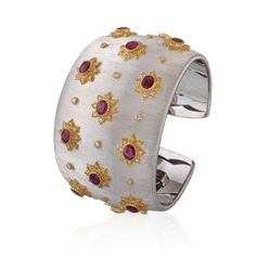 Bracelets de Rêves' Collection. Buccellati Dream Cuff Bracelet in white and yellow gold with rubies, diamonds and fancy yellow diamonds.