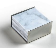 4 Square Carrera Marble Coasters in a Stainless by Marbleandmetal