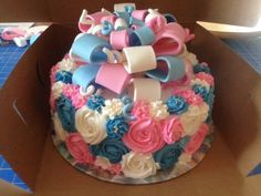 """This was a """"surprise"""" cake for a baby gender reveal party. Inside there were pink M & M's to announce that the baby is a GIRL."""