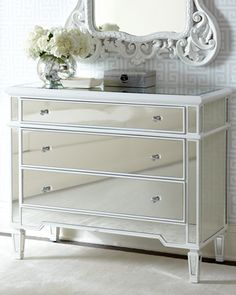 Hollywood glamour takes on a new look with our Stunning Elsby Mirrored Chest. Our Elsby mirrored chest features beautiful white detailing and round glass knobs with nickel accents. Mirrored Furniture, Luxury Furniture, Bedroom Furniture, Home Furniture, Furniture Design, Bedroom Decor, Master Bedroom, Bedroom Ideas, Glass Furniture