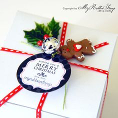 A little gingerbread man, a jingle bell, and a holly berry/leaf is such a sweet combination and wonderful little touch to complete the wrapping of this Christmas gift.