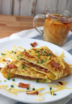 A delicious, super simple #keto omelette filled with bacon, cheddar, and chives. A must try! Shared via http://www.ruled.me/