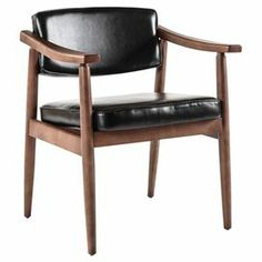 """Add a timeless touchto your living room or master suite with thislovely arm chair, showcasingfaux leather upholstery and a walnut finish.    Product: ChairConstruction Material: Beech and polyurethaneColor: Walnut and blackFeatures: Upholstered seat Dimensions: 27.5"""" H x 17"""" W x 24.5"""" D"""