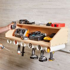 Learn how to build your own drill dock organizer for easy and clutter-free access to one of your most used power tools. Read on to learn how! Garage Tool Storage, Workshop Storage, Garage Tools, Diy Storage, Storage Ideas, Workshop Ideas, Garage Shop, Storage Systems, Creative Storage