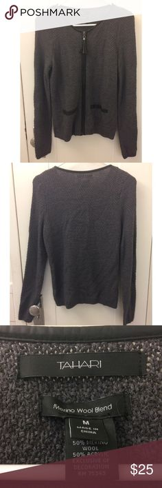 Tahari Leather Trim Wool Zip Sweater Super soft dark grey sweater from Tahari. Has leather trim and a leather tassel on the zipper. Pockets on the front are faux. In excellent condition! Cheaper on Ⓜ️erc! Tahari Sweaters Cardigans