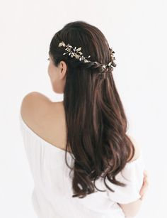 Lightweight crown inspired by delicate vines seen on Chinese coromandal panels hand-wired with pearls, crystals, and leaves Can be worn both on the front and th
