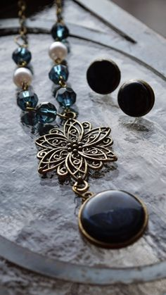 This necklace and earrings set just got added to a Etsy treasury called Depth by Oksana