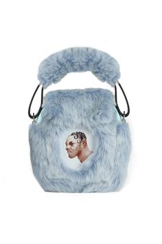 #NasirMazhar faux fur purse. Made in England. Inspired by illegal raves in 60s Britain—and this furry little bag fits right in. Covered in baby blue faux fur, it features a picture frame on the front for showing off memories from your wildest parties. Under the flap is a zippered compartment to hold your necessities.