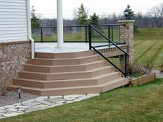 Splayed trex composite deck stairs onto stamped concrete for Fiberon decking cost per square foot