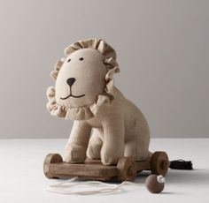 Lion - Our favorite Chambray Animals, transformed into a pull toy! As your child grows, simple pull-along toys help nurture development. What make ours so special are the heirloom-quality details – the wooden wheels, natural rope pull-string and the sweet embroidered accents.