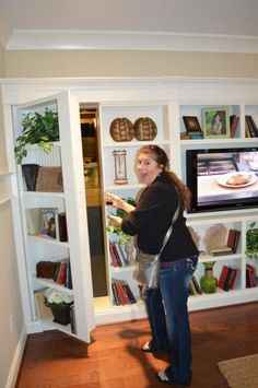 Secret room! This would be a great idea for our next house! John would LOVE to have a DVD room!
