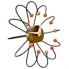 Frederic Weinberg Large Mid Century Atomic Ball Wall Clock.  This is the actual clock, but I bet you could do a DIY upcycle recreation.