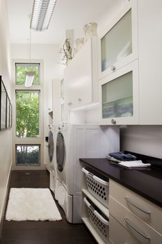 This design suits the narrow laundry space, and it's light-filled and practical.