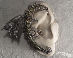 Dragon ear wrap  #ArtisanCrafts / #Jewelry / #Earrings / #Piercings Adjustable unisex ear wrap made of nickel free silver plated wire, green fire polished beads, delicas and tiny Japanese seed beads. Oxidized and carefully polished.