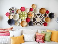 everything is perfect.  baskets as wall art, pillows. pattern and solid prints.