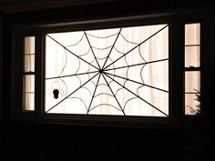 Spiderweb Window Decor for Halloween >> http://blog.diynetwork.com/maderemade/2013/10/17/simple-and-quick-halloween-window-decorations?soc=pinterest