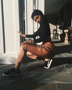 Kylie Jenner wearing Etro High-rise Cigarette-leg Satin Trousers https://api.shopstyle.com/action/apiVisitRetailer?id=522605947&pid=uid7729-3100527-84 and Puma shoes https://api.shopstyle.com/action/apiVisitRetailer?id=435444442&pid=uid7729-3100527-84. #style #celebstyle #etro #puma #instafashion #trousers #shoes