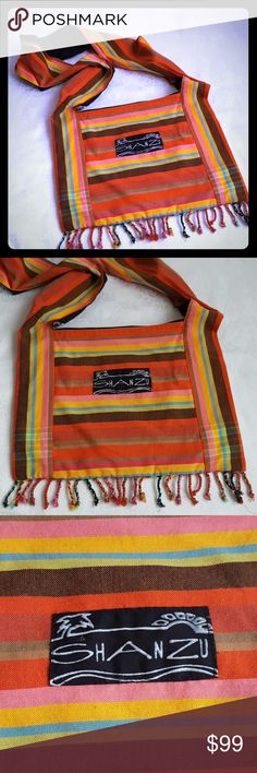 """🔥DISC SHIP🔥Boho Chic Striped Crossbody Tote Bag Boho chic bright striped cotton fabric crossbody carry all tote like bag with fringe. Zip top closure. Black cotton lining with 1 large interior pocket & 1 zippered pocket. Made in Kenya.  Bag measures approx 16"""" wide x 12"""" tall. Strap is about 25"""" long. Bag lays from hip to mid thigh. Can be knotted to adjust. Excellent used condition. Smoke free and pet free home.  Check out my other listings - 100's of 👠shoes👠, 👢boots👢 and 👜bags👜…"""