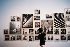 love the black and white gallery style wall