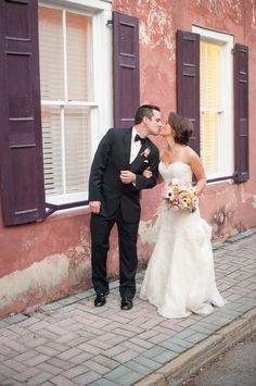 Bride and groom kiss--a gorgeous St. Augustine wedding, shot by Kate Gardiner Photography in front of the Marine Street side of our bed and breakfast!