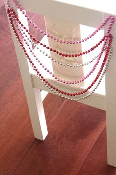 party chairs with dollar store necklaces and glue dots