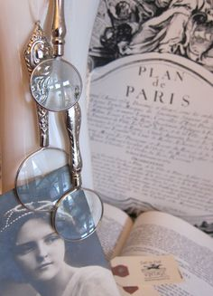 Romantic Vintage accessories: silver magnifying glasses displayed on an antique glove mold ceramic hand.