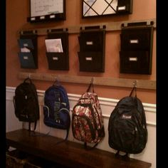 """Welcome home"" organization station--places for backpacks, homework to do, slips to be signed, and a calendar with upcoming events."