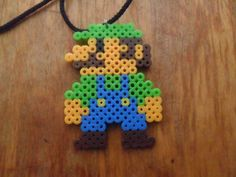 8 Bit Luigi Inspired Perler Bead Necklace. $4.00, via Etsy.