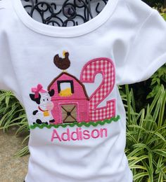 Appliqued Barn in Hot Pink With Age Appliqued in Hot Pink Gingham Check with embroidered farm chicken up top and Little cow beside with Bow up top. Finished with Lime Green Ric Rac below button sewn on door center. This tee will be perfect for a Farm themed birthday or for just everyday!!   ****PLEASE NOTE NAME, AGE AND SIZE NEEDED( AVAILABLE SIZES BELOW) IN THE NOTES TO SELLER DURING CHECKOUT***  Colors can be changed to meet your party theme...just convo me with your requests.  Available…