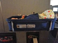 Excellent tips and ideas for traveling long distance with a baby or toddler. International flight suggestions to make the trip less stressful for mom and baby.
