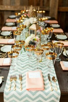 Glamour chic - peach and mint and gold - chevron runner - gold cutlery - interesting glassware - exposed wood table - lantern centerpiece