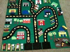 by http://craftysoccermom.blogspot.com/  Some helpful tips:  Make sure you have lot's of Glue Gun Sticks  You can buy sheets of felt at the Dollar Store but the green piece I got prepackaged at a craft store (it's 36 x 36)  Use train tracks (Thomas plastic or wood tracks ) as a stencil when making the roads, if you have them