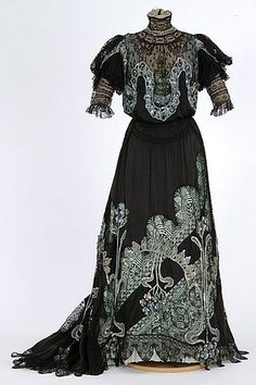 Black satin and lace gown with sequin and bead trim. Made by dressmaker Mary Molloy, Minneapolis, Minnesota, circa 1904-1908.