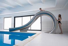 Design studio Splinterworks has created a sculptural waterslide that is designed to mimic the barrel-shape of a wave before it breaks.