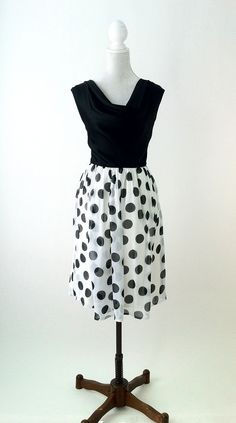 1950s vintage style black and white polka dot dress. New item, this is made of a soft, silky rayon fabric for the bodice with a draped, cowl neckline. The skirt is constructed of a white chiffon overl
