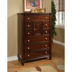 Made from kiln-dried solid poplar with birch veneers, this traditional eight-drawer chest features a brown cherry finish and brushed silver hardware. The four full-size drawers and four accessory drawers give you plenty of storage space.
