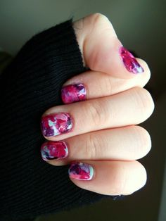 Water-Color Nail Art using saran wrap. Crazy easy. White base coat, cover nails with drops of polish (no more than 4 colors), place over with wrap and pretend to finger-paint!