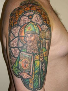 St Patrick stained glass window tattoo paulie tat on bicep custom designed by jess St Patrick stained glass still goin on it gonna be a sleeve done by Jessica Morsey at Parlor City Tattoo Johnson City Catholic Tattoos, Religious Tattoos, Life Tattoos, Body Art Tattoos, Color Tattoos, Tatoos, Traditional Tattoo Sketches, Stained Glass Tattoo, Irish Tattoos