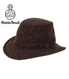 Our classic winter Hat is made in beautiful, warm authentic Harris Tweed. Discreet earwarmers can be pulled down on cold days.