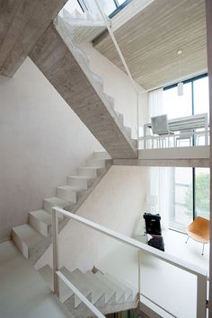Nest by CSD Architecten A beautiful contrast of white plastered finish with exposed concrete on the bottom and sides of the stairs.