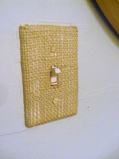 burlap switchplate. i'm thinking hot glue and then tacky glue behind plate before screwing it on. HELLO!