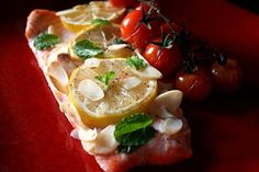 Rainbow trout baked with almonds, cherry tomatoes and mint.