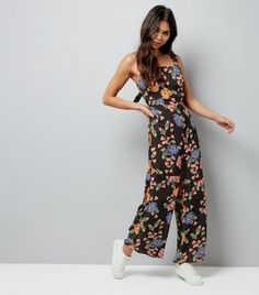 Tall. Play with flirty florals in this sleeveless jumpsuit. Pair with white trainers for a casual look.- All over floral print- Wide straps- Square neckline- Tie back fastening- Keyhole back- Side pockets- Wide leg- Cropped length- Full length ( as shown): 56.5