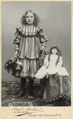 Found this pinned as a post-mortem girl with doll, but I she was, obviously, very much alive. If there is a posting stand behind her, it was merely used to help her hold the pose and keep still during the long exposure time that was required back then.