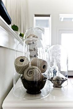 yarn rolls under glass domes