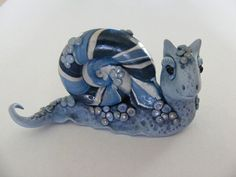 cool clay snail... no tutorial, but inspirational