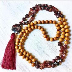Raw garnet  sandalwood = stunning Mala jewelry!  Check out this beautiful shop and grab the #discount below for extra savings!  Exclusive 24 hour discount // HELLOLOVE30 for 30% off  #handmade #handmadewithlove #makersgonnamake  #handmadeshop #lovelysquares #mala #garnet #sandalwood #malanecklace #handmadejewelry #pinjewelry