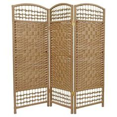 """Three-panel room divider with kiln-dried wood frames.  Product: Room dividerConstruction Material: Wood and plant fiberColor: NaturalFeatures:  Three panelsDiamond medallion open weave designOpen lattice at top and bottom Dimensions: 47.25"""" H x 48"""" W x 0.75"""" D"""